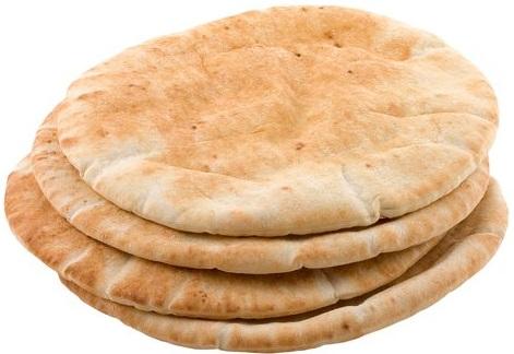 上图:皮塔饼(Pita)是以色列常见的有酵饼,主前2500年就出现于美索不达米亚。Pita饼只稍稍发酵,中间由蒸汽膨胀形成一个口袋,面饼冷却后变得平坦,里面有一个口袋。