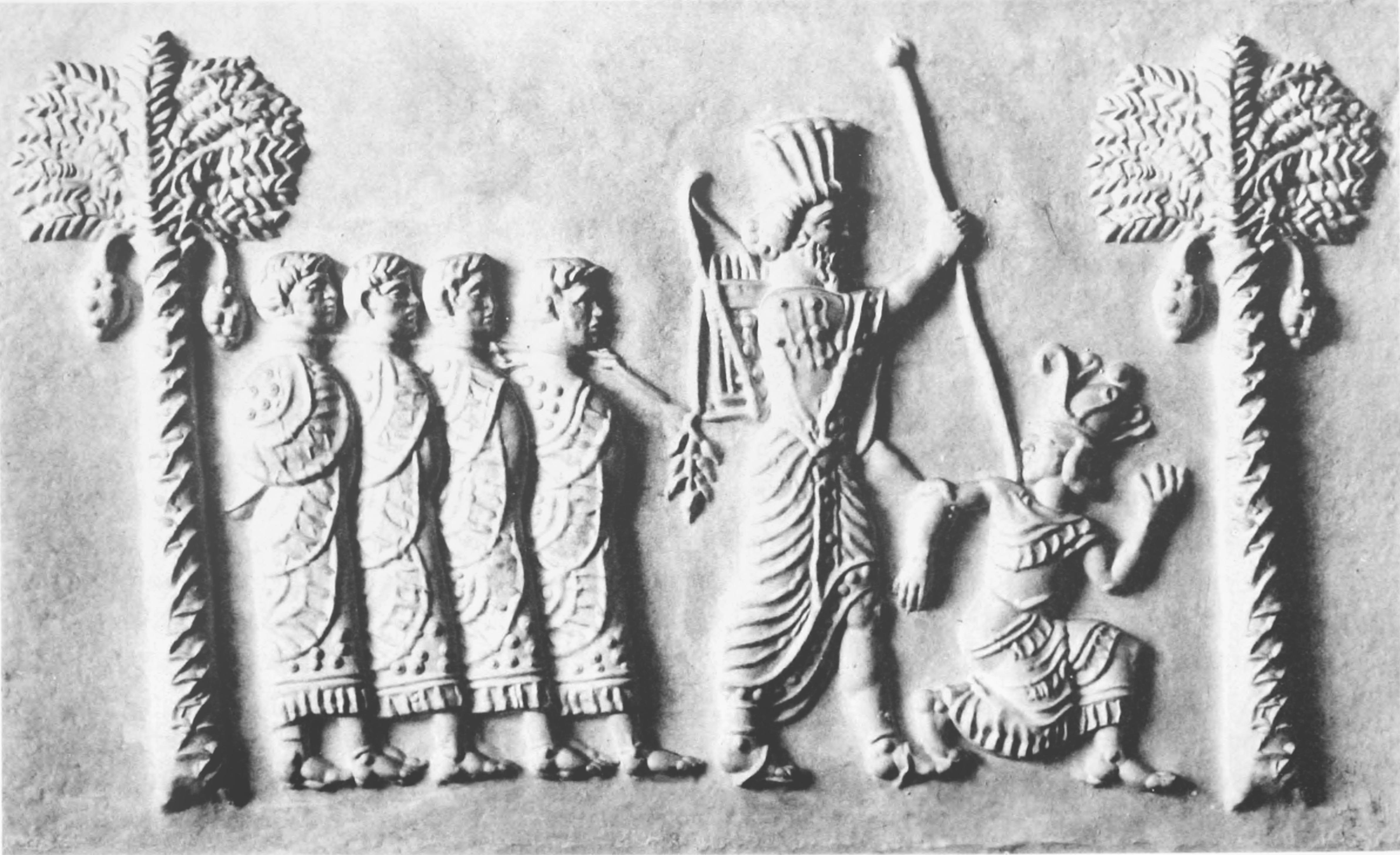 上图:波斯阿契美尼德帝国时代印章上的图案《波斯国王和被打败的敌人Persian king and the defeated enemies》,描绘的可能就是亚达薛西王打败埃及叛军的情景。波斯王一只手抓住跪着的埃及王,另一只手握着长矛,后面用一根绳子牵着四个俘虏。