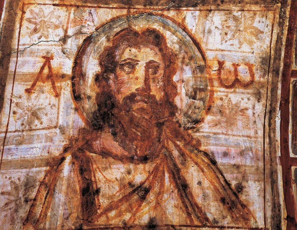 上图:主后4世纪晚期罗马康茂迪拉殉道者墓窟(Catacombs of Commodilla)中的基督壁画,是最早的大胡子基督画像之一,基督画像的左边写着「阿拉法」(大写Α),右边写着「俄梅戛」(小写ω)。殉道者墓窟(Catacombe di Roma)是罗马及附近的古代地下墓穴,始于2世纪,以应对土地短缺、以及受迫害的基督徒秘密埋葬的需要。罗马地下柔软的火山岩非常适合开挖隧道,因为它第一次暴露在空气中时是软的,随后就变硬。这些墓道通常长达数公里,多达4层。