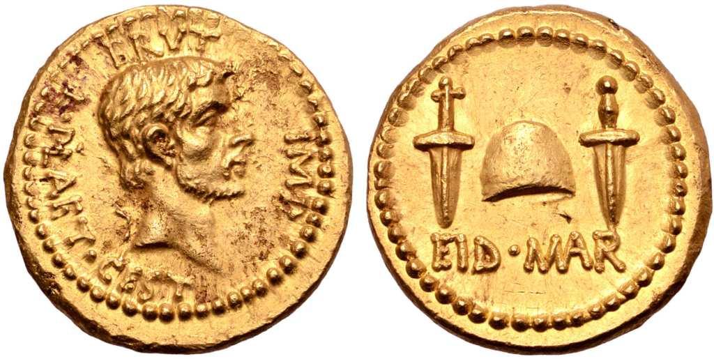 上图:主前42年秋天,布鲁图斯(Brutus)在腓立比即将战败之前发行的金币,庆祝元老院于主前44年3月15日三月节(Ides of March)刺杀凯撒。正面是自称「我爱凯撒,我更爱罗马」的布鲁图斯,背面写着「在三月节」的缩写EID MAR(Eidibus Martiis – on the Ides of March) ,中间是两把匕首之间的自由帽(Cap of Freedom)。自由帽是罗马奴隶被释放时传统戴着的帽子,但刀剑所带来的自由并没有长久,罗马共和国经过多年内战,于主前27年变成了专制独裁的罗马帝国。